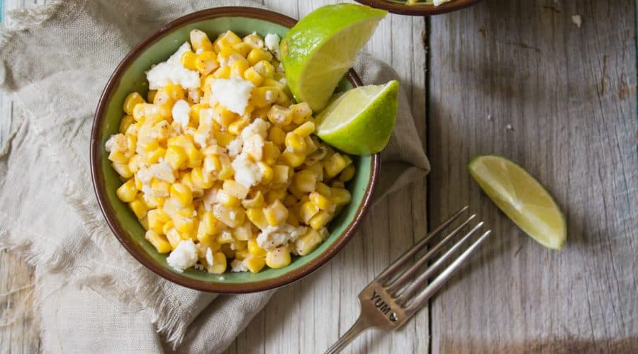 Corn kernels mixed with mayonnaise, melted butter, and queso fresco cheese then seasoned with chili powder and lime juice. This easy to make Mexican Street Corn is delicious and perfect as a side. | Cooking With a Wallflower