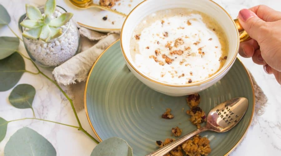 Strong brewed coffee latte served with pumpkin puree, maple syrup, and oats. This maple pumpkin almond oatmeal latte is delicious and perfect for fall. | Cooking With a Wallflower