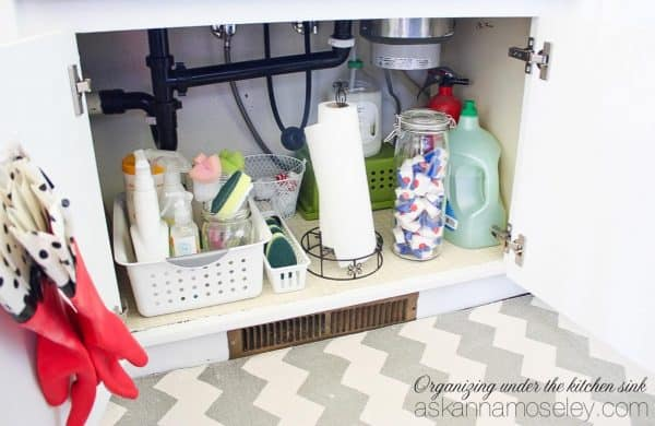 Overwhelmed by how much there is to organize in your house? Start one room at a time! In this post I'm sharing 10 cheap and easy kitchen organization tips, from tupperware lids and kids snacks to pans and cleaning products. | Ask Anna