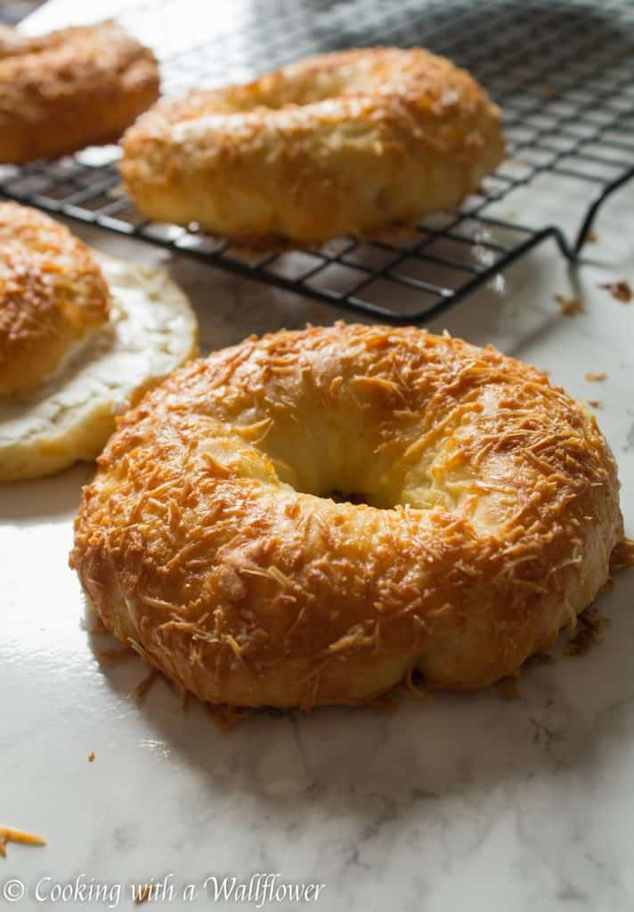 Homemade bagels topped with freshly grated Parmesan cheese, these homemade Parmesan bagels are delicious and easy to make. | Cooking with a Wallflower