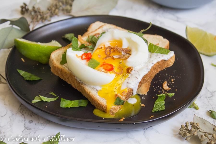 Toast with a garlic za'atar spread, topped with an egg and fresh herbs, this garlic egg toast is delicious, easy to make, and perfect for summer breakfast. | Ask Anna