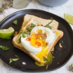 Toast with a garlic za'atar spread, topped with an egg and fresh herbs, this garlic egg toast is delicious, easy to make, and perfect for summer breakfast.   Ask Anna